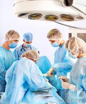 surgical-team-around-table-with-lights-overhead